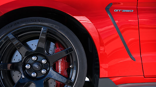 "Six piston Brembo® front brake calipers and 15.5"" two-piece cross drilled iron discs mounted to aluminum hats"